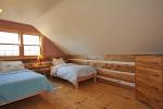 Serene loft bedroom at 453 Dobbie Road