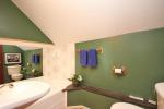 Green bathroom at 453 Dobbie Road
