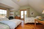 Green bedroom at 453 Dobbie Road