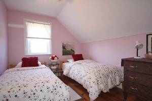 One of the nine bedrooms at 453 Dobbie Road