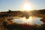 Retreat for sale - sunset over pond on 94 acres